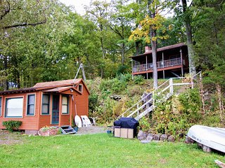 Double the fun! Two rustic lakefront cabins w/ private dock & beach!