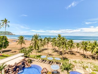 Upscale, beachfront condo with shared pool and spacious balcony!