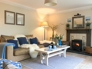 Spacious and cosy living room with TV, woodburner and doors to the terrace.