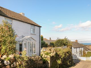 FUCHSIA COTTAGE, historic cottage with super views, overlooking popular Cornish