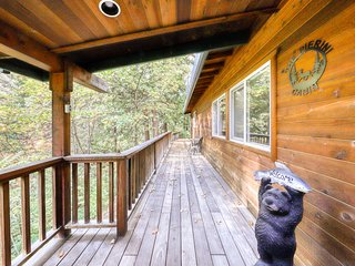 Dog-friendly home in a forested setting w/ a large deck & shared rec center!