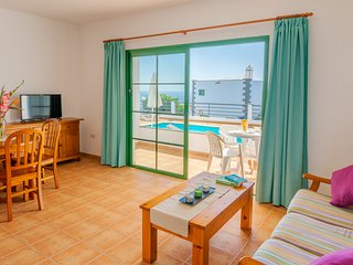 Beautiful apartment near the beach w/ shared pool, private terrace, & free WiFi