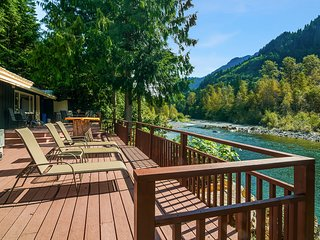 Lovely riverfront property w/ two houses - private hot tubs, firepit - dogs ok!