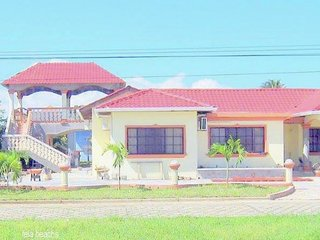 Beach house with backyard pool located within a gated community.