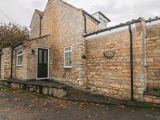 22 BECKSIDE, family friendly, character holiday cottage, with a garden in