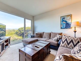 Modern dog-friendly condo on the beach w/ great views! Enjoy shared hot tub!