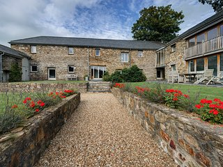 Secluded luxurious barn conversion sleeping 12 with indoor pool and own vineyard