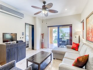 Upscale condo with shared pool and gym, beachfront