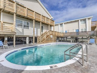 Condo near the water w/ a shared, outdoor pool, gas grill, & beach access!