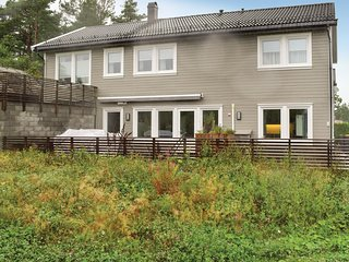 Amazing home in Grimstad w/ 4 Bedrooms (NAS030)