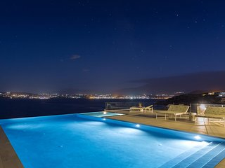 Exclusive seafront location with heated infinity pool, hot tub and sea views