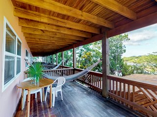 Romantic studio with balcony and water views,  hammock, restaurant&dock on-site
