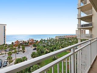 Bright beach condo with water views & private balcony - pool, gym & beach!