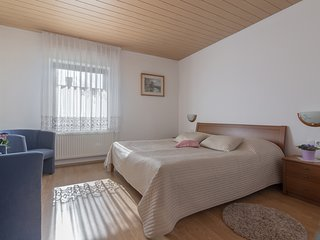 A king size bed (180 x 200 cm) and two armchairs in the second bedroom.