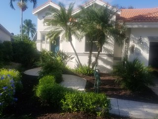 NAPLES BEACH HOUSE ON GOLF COURSE WITH YACHT CLUB AT 'WINDSTAR ON NAPLES BAY'