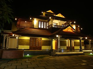 Luxury budget traditional kerala villa with pool near Kochi Airport