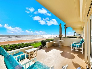 Ocean view condo w/ a private balcony, shared pool, & direct beach access