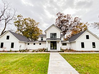 Modern, riverfront home w/ a gourmet kitchen, private hot tub, firepit, & dock