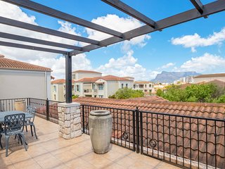 Modern condo with garden views, private balcony & free Wi-Fi