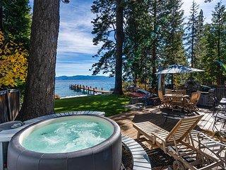 Lakefront Haven w/ Backyard Beach, Dock & Hot Tub - Walk to Homewood Slopes!