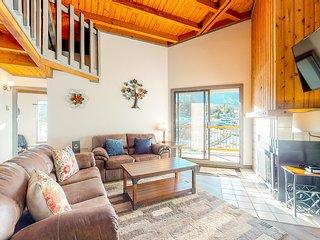 Lofted mountain condo w/ balcony, fireplace & shared hot tub/pool/game room!