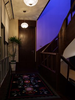 The stairs to 2nd floor from Living room. Night time