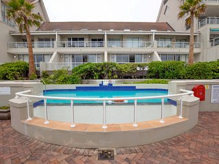 Beachfront condo with beach access, shared pool, and TV cable