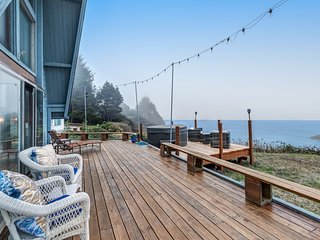 Oceanfront home with private hot tub, deck, & sweeping views!