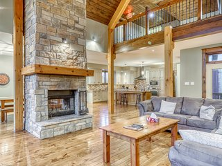 Large & open chalet w/ a tiered deck, private hot tub, & yard - close to skiing!