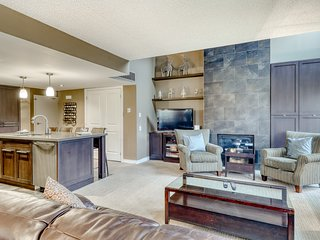 Spacious open concept condo w/shared swimming pool, small balcony & lawn views!