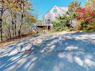 Family home in the trees w/ wrap-around deck & fireplace - near beaches, dogs OK