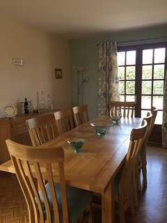 dining area, dining table seats 8 persons