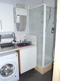 Utility Area Washing machine + Coffee making area serving the patio area. + Shower No III