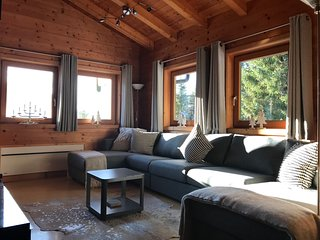 Premier self catering private log cabin with amazing mountain views in village.