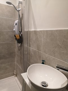 Low level shower in the toilet.