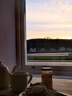 Enjoy breakfast with a winter sunrise.