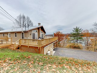 Contemporary, lakefront, dog-friendly cottage w/ large decks & a private dock