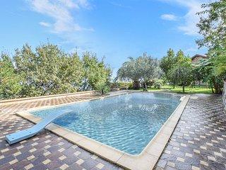 Nice home in Montepaone w/ Outdoor swimming pool, Sauna and 4 Bedrooms (IKK488)
