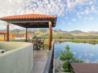 Lakefront home w/lake & golf views from the terrace, and three shared pools