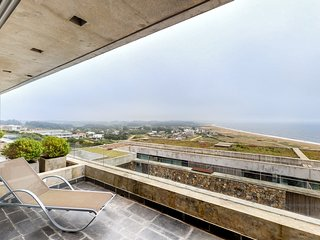 Sleek two-story apt. w/ocean and beach views from balcony & shared pool