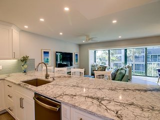Mariner Pointe 732: New Gorgeous Remodel and Stunning Canal & Side Bay Views!