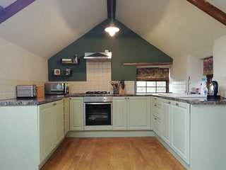 Cook up a feast in the kitchen, equipped with fridge, freezer, dishwasher, microwave, oven &hob