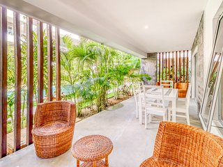 Confortable apartment with patio area, garden views, and shared pool
