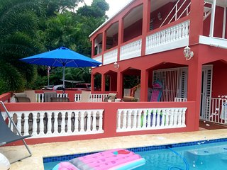 Large secluded family vacation house with private pool. Near rainforest & beach!