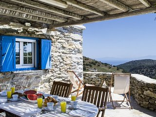 Tradinional stone farmhouse with a view of the surrounding hills and the sea