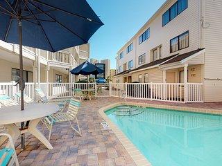 Ground floor condo w/ shared pool - walk to the beach!