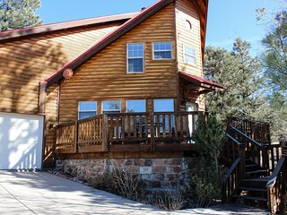 Dog-friendly, luxury cabin w/ a private hot tub, wood stove, & mountain views!