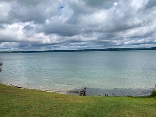 NEW! Torch Lake Home w/116ft of Blue Water Access