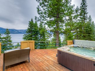 Stunning lake views, saltwater hot tub, pellet stove & dog-friendly!