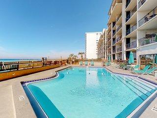 Cozy, beachfront condo w/ a full kitchen, balcony, & easy beach access
